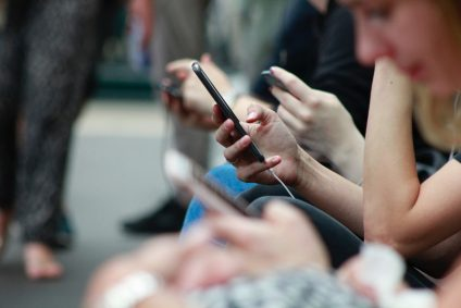group of people on mobile phones