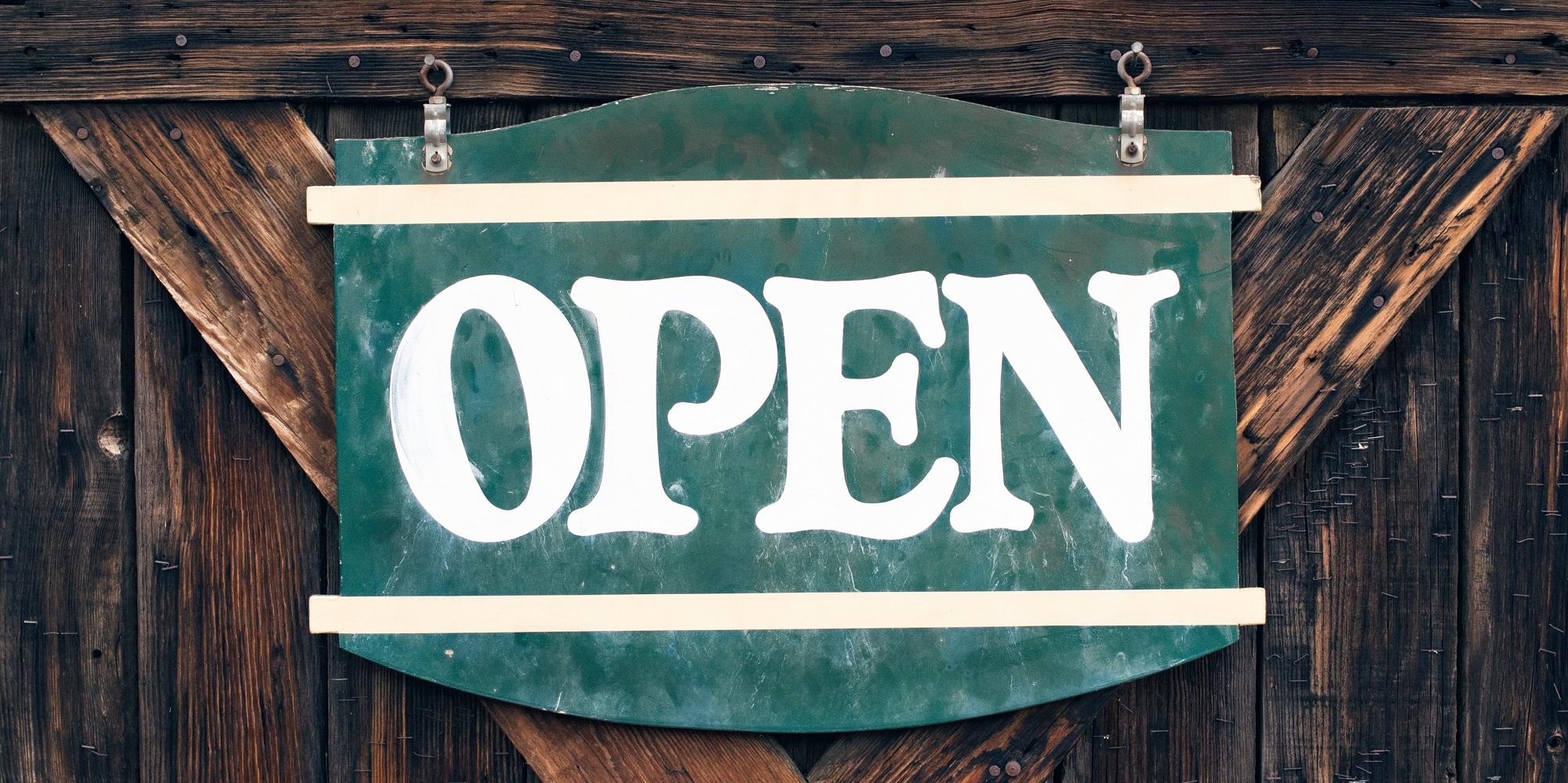 open sign on wooden door