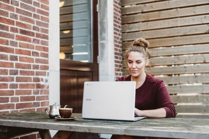 woman sat outside on laptop