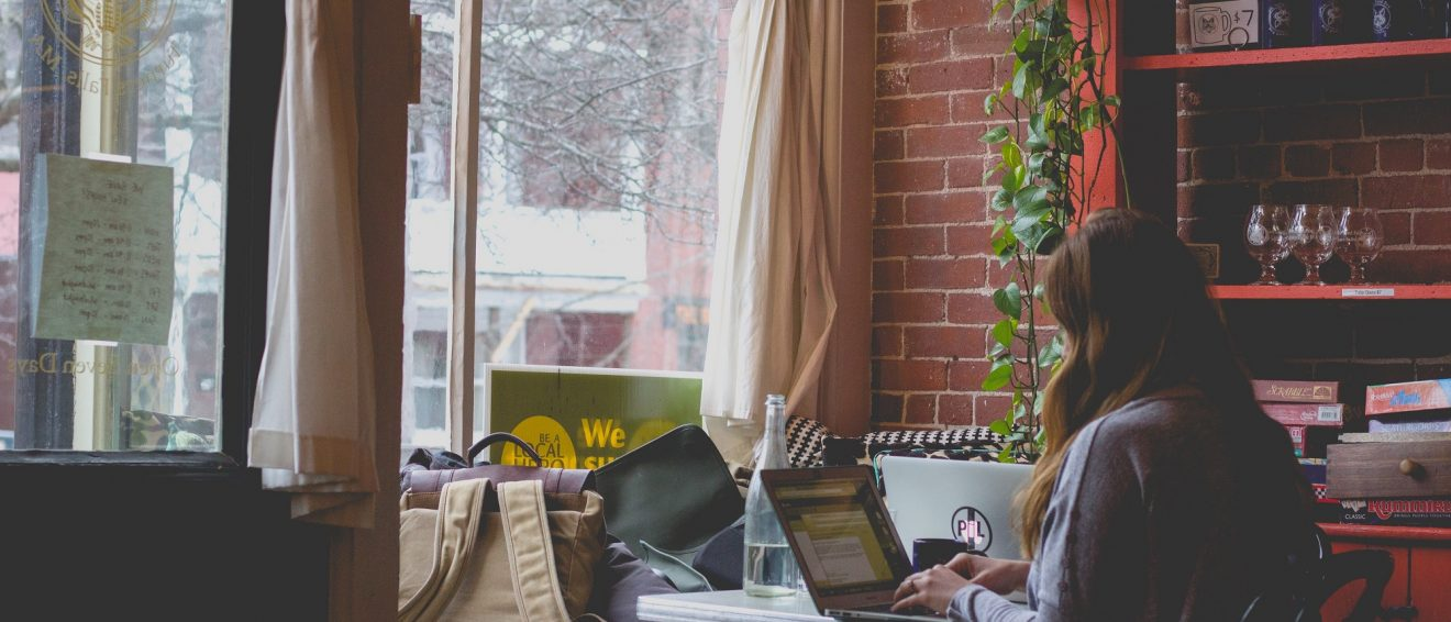 lady in coffee shop on laptop