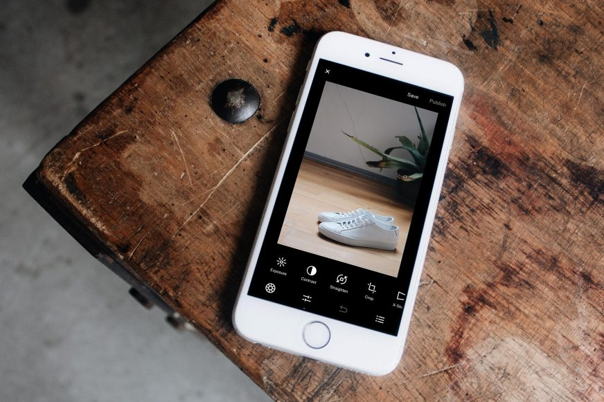 Mobile phone with a photo of a pair of trainers on the screen