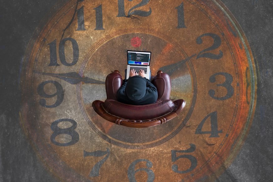 person sat in chair in middle of clock face