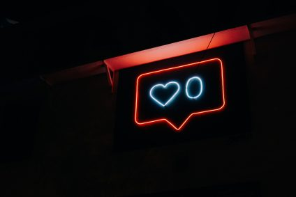 social icons on neon sign