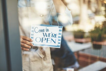 come in we're open sign in a shop window