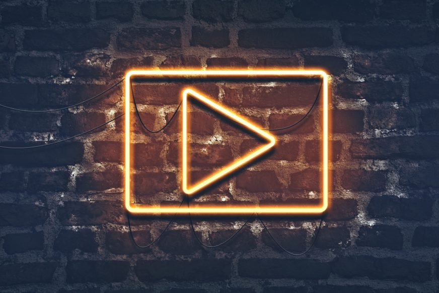 neon play video icon on wall