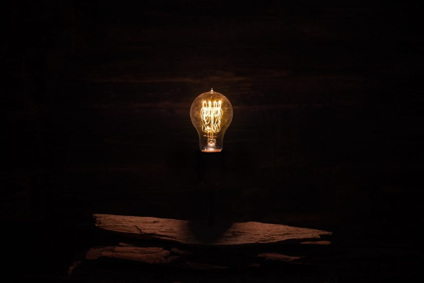 lightbulb against dark background