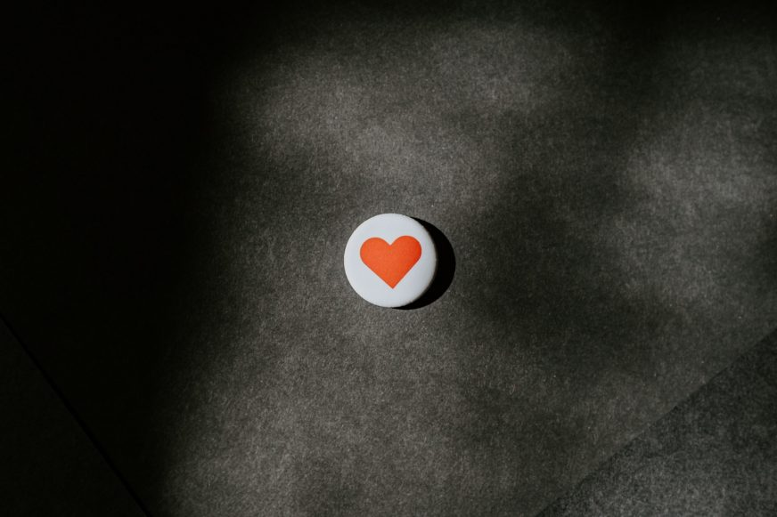 small red heart badge