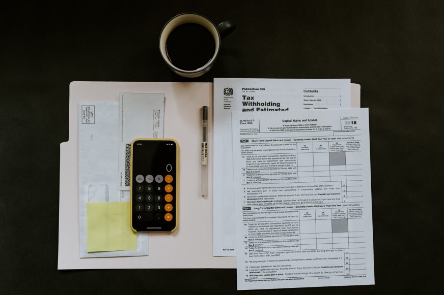 various tax paperwork on desk