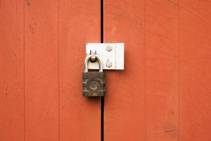 padlock on orange doors