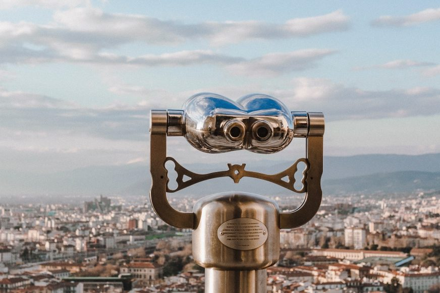 Binoculars over city landscape