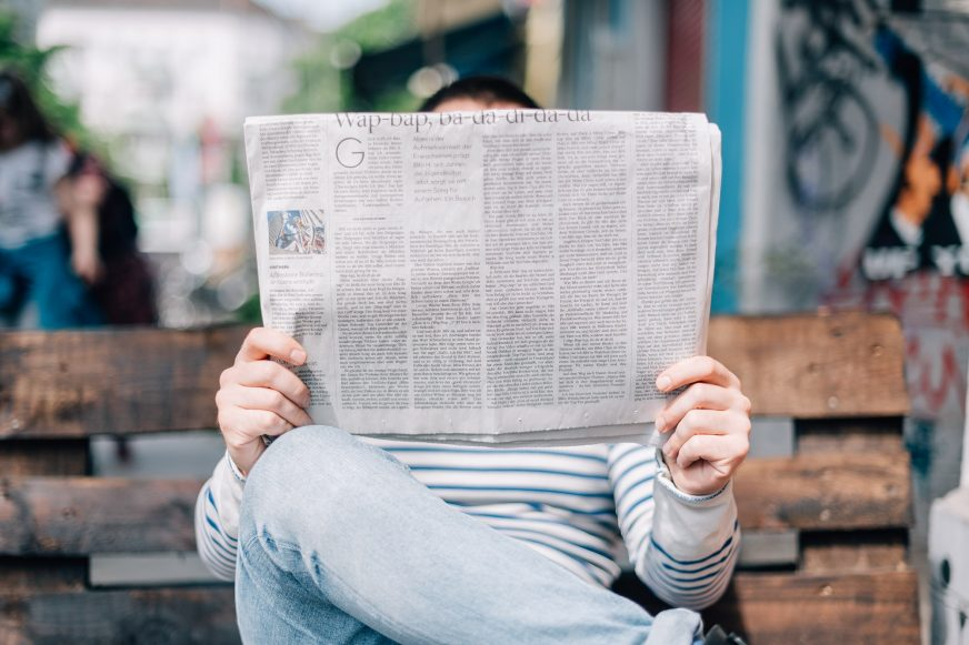 someone reading newspaper